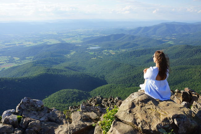 Adult Beauty In Nature Day Horizontal Landscape Looking At View Mountain Mountain Range Nature One Person One Woman Only Only Women Outdoors People Person Rear View Sitting Sky Travel Travel Destinations Vacations
