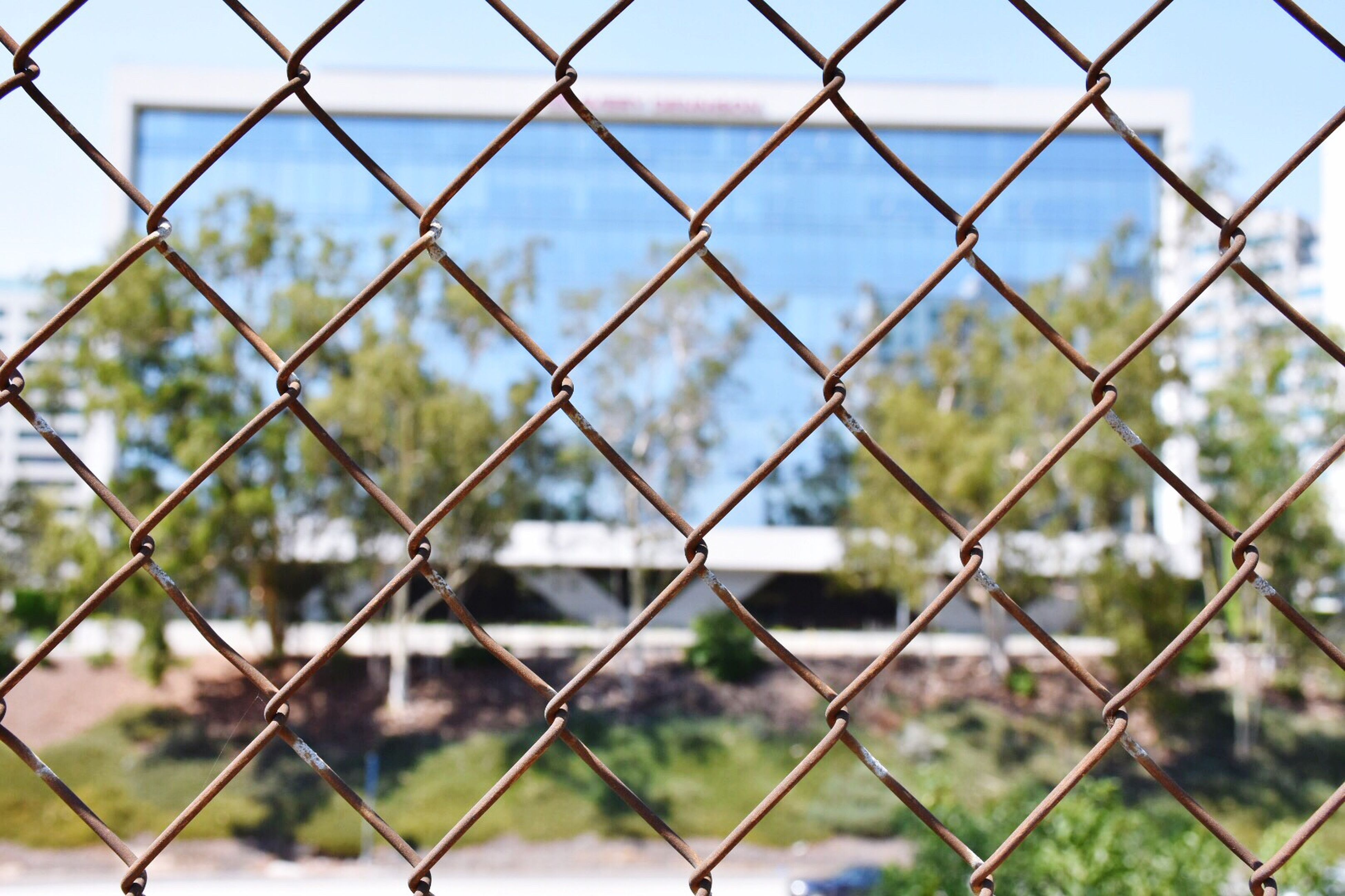 chainlink fence, protection, safety, security, metal, focus on foreground, full frame, day, pattern, no people, outdoors, close-up, crisscross, nature, sky