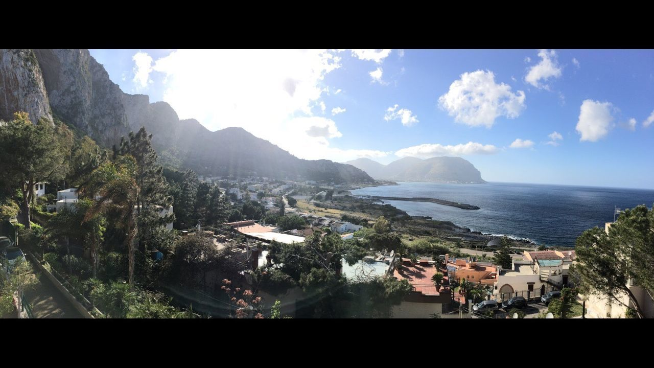 mountain, panoramic, sea, no people, architecture, building exterior, town, day, nature, beauty in nature, landscape, scenics, sky, water, outdoors
