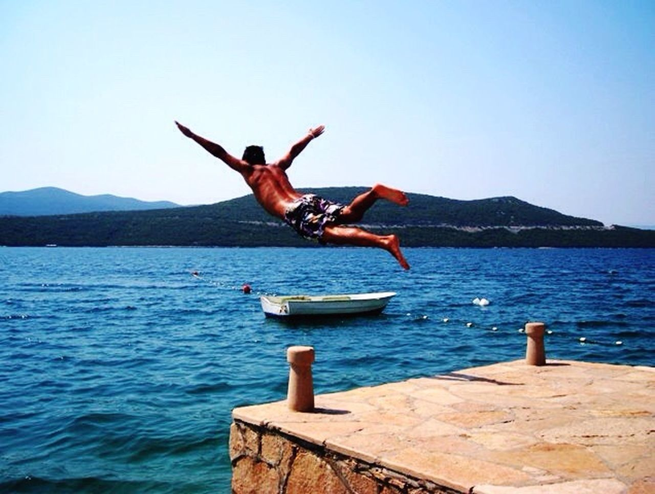 jumping, full length, water, mid-air, day, vitality, blue, sea, outdoors, fun, adult, nature, one person, mountain, men, adventure, sky, adults only, only men, one man only, clear sky, people, taking the plunge, swimming, flying, young adult