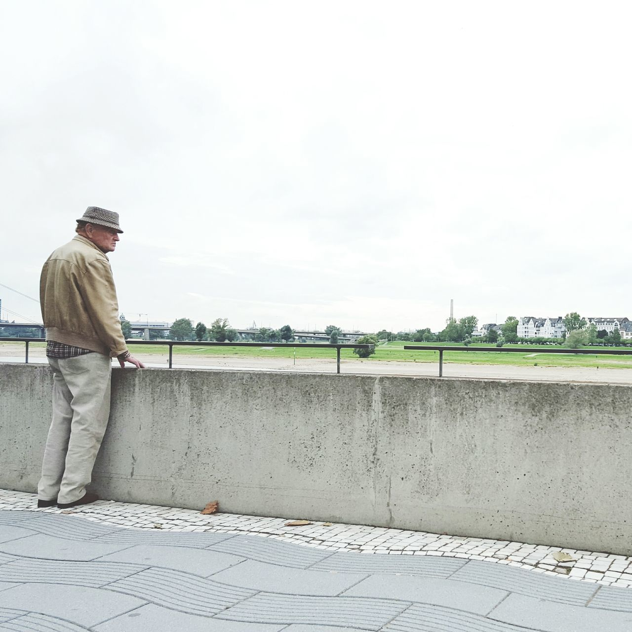 When people match places. The Portraitist - 2016 EyeEm Awards The Architect - 2016 EyeEm Awards Old Man Standing Next To A Wall Ceiling Wearing Hat Architectural Detail Floor Concrete Stone Floor Lines & Curves Silhouette Of A Man Urban Landscape Urban Geometry Pavement Waiting For Something Enjoying The View Stroller Textures And Surfaces From My Point Of View EyeEm Best Shots Facades Light Colors Shades Of Grey Architecture