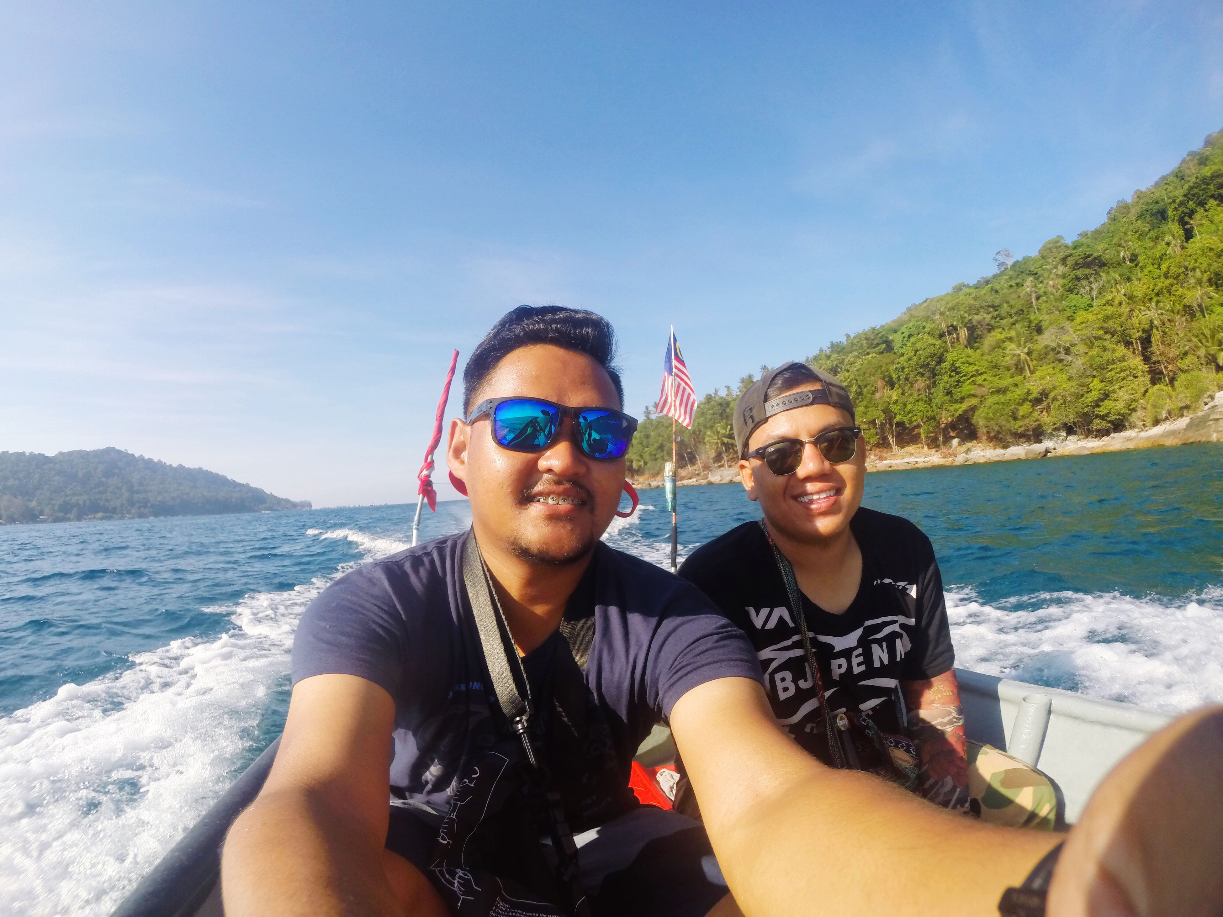 lifestyles, leisure activity, person, looking at camera, young adult, portrait, water, young men, vacations, smiling, sea, front view, sunglasses, happiness, togetherness, enjoyment
