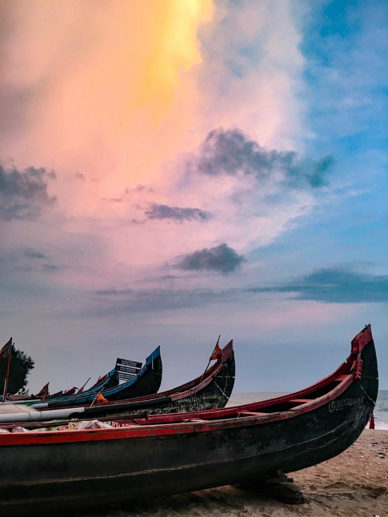 Nature's way of painting the sky. Beach Beachphotography Beauty In Nature India Kerala Longtail Boat Nature Sky Summertime Sunset Water First Eyeem Photo