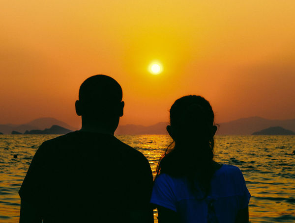 Love Watching The Sunset Beach Beauty In Nature Bonding Men Mountain Nature Orange Color Outdoors People Real People Rear View Scenics Sea Silhouette Sky Standing Sun Sunset Togetherness Two People Water Women