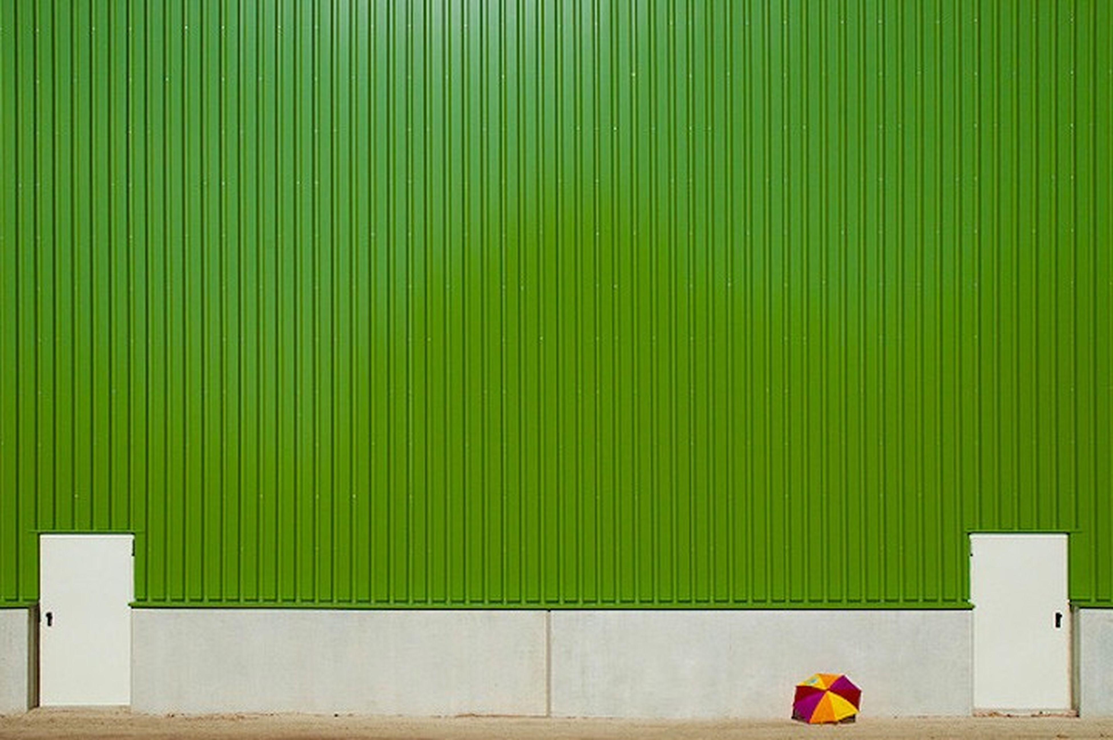 red, green color, pattern, built structure, striped, high angle view, grass, safety, day, in a row, architecture, protection, outdoors, building exterior, wall - building feature, childhood, low section, multi colored