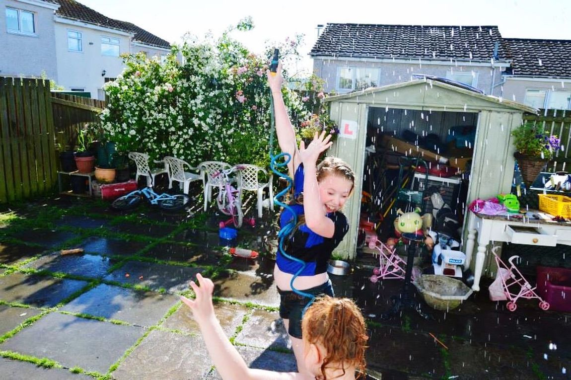 Enjoy The New Normal Fun People Playing Happiness Inspiration Friendship Only Women Day Outdoors Life Family Back Garden Water Fight