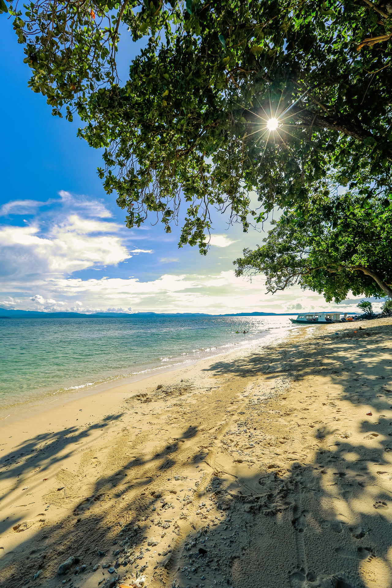 Bangka Island Beach Beauty In Nature Blue Day EyeEm EyeEm Nature Lover Growth Horizon Over Water Idyllic Landscape Landscape_Collection Nature Outdoors Sand Scenics Sea Sky Sun Tranquil Scene Tree Water Wave Flare Islands