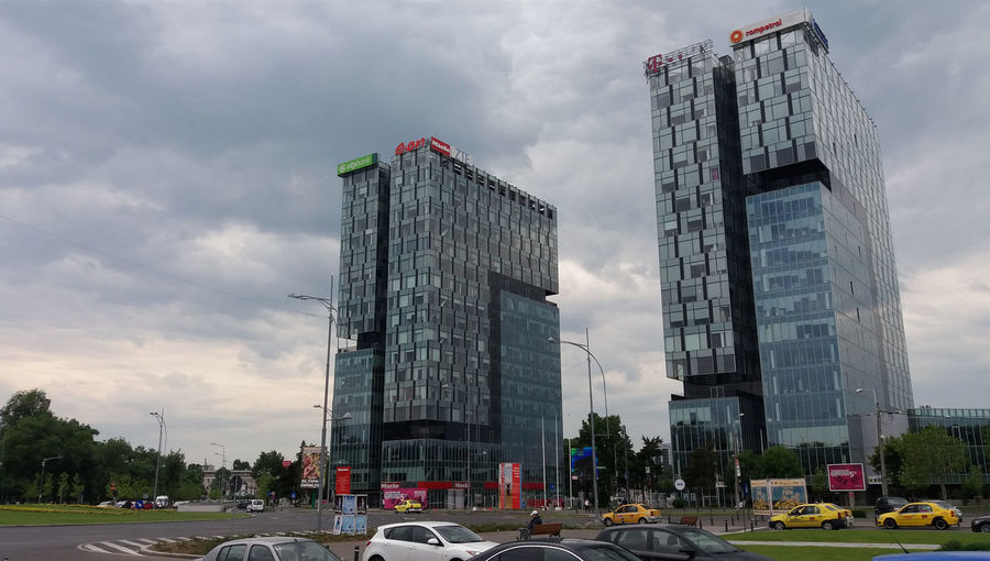 Bucharest, Romania - May 20, 2017: View of City Gate Towers situated in Free Press Square, in Bucharest, Romania. May 20, 2017 Architecture Architecture Bucharest Building Building Exterior Buildings Built Structure Car City City Gate North Tower City Gate South Tower City Gate Towers Cityscape Cloud - Sky Cloudy Sky Edifice Free Press Square Landmark; Romania Structure Tourism Town Travel; Urban; Wings; First Eyeem Photo