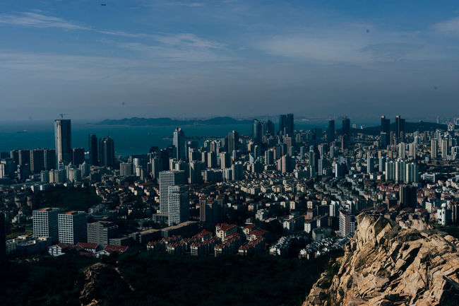 Looking over Qingdao from Fushan Aerial View Architecture Built Structure China City City Life Cityscape High Angle View Outdoors Sky Skyscraper Tall - High Tower Urban Scene Urban Skyline Water