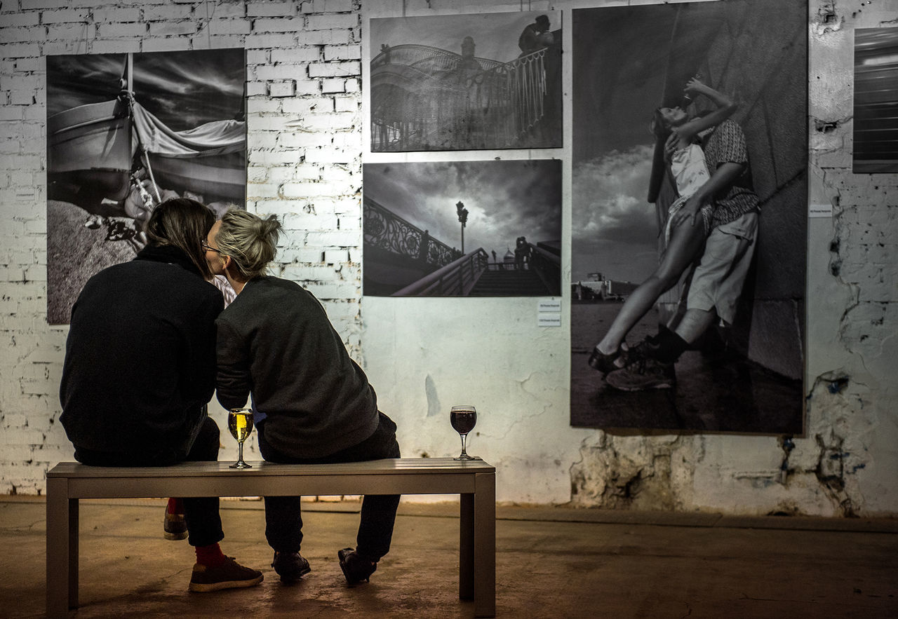 Russia, Moscow, exhibition, kissing, love, wine, humor Casual Clothing Day Exhibition Full Length Humor Indoors  Kissing Love Moscow Real People Russia Sitting Two People Wine Young Adult