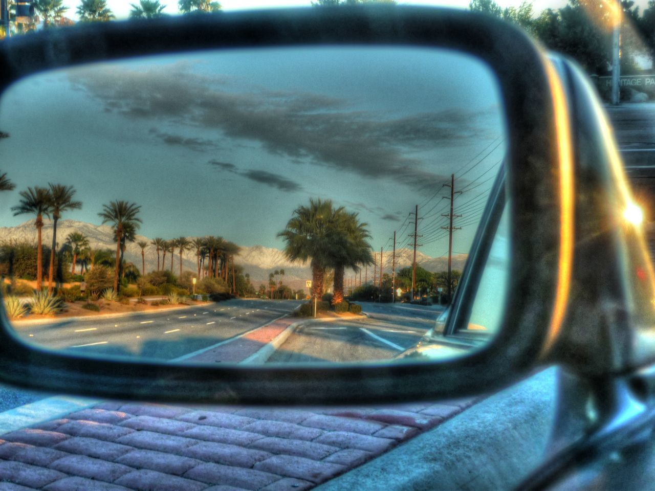 car, transportation, side-view mirror, reflection, tree, land vehicle, sky, car interior, windshield, window, road, day, no people, vehicle mirror, outdoors, nature, close-up