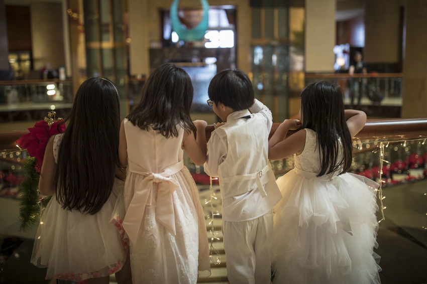 Children Wedding Bridesmaids Celebration Day Guests Indoors  Lifestyles No Faces People Real People Rear View Wedding Dress Women