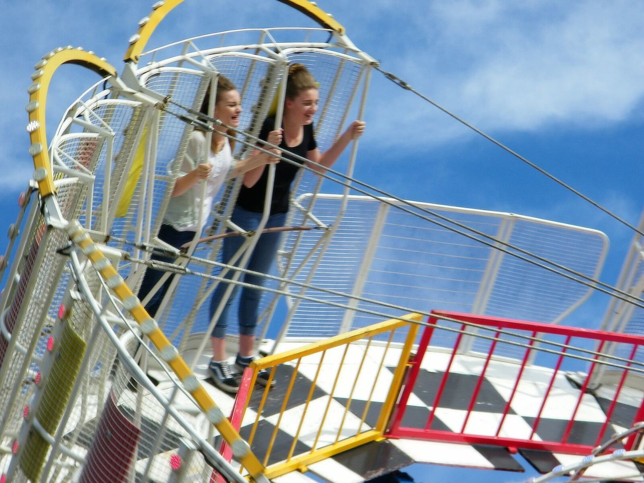 railing, outdoors, amusement park, low angle view, day, sky, sea, amusement park ride, real people