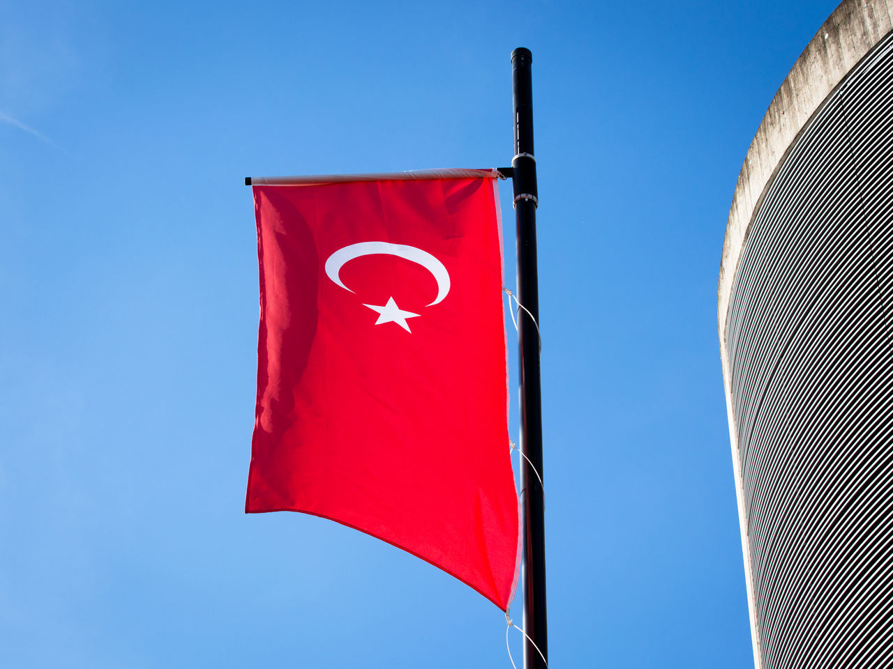 flag, red, patriotism, day, low angle view, blue, clear sky, wind, outdoors, no people, pride, sky