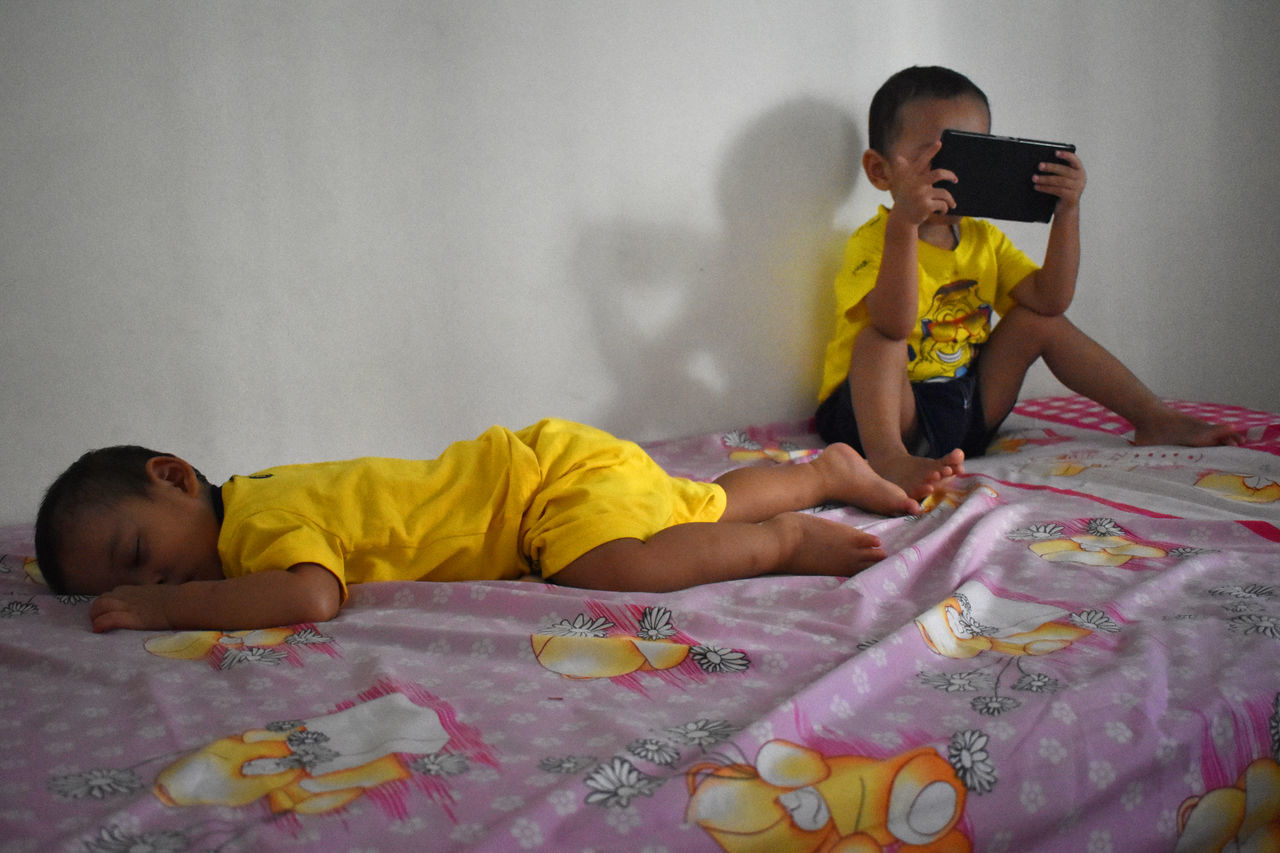 change player Bed Bedroom Boys Child Childhood Children Only Day Domestic Life Home Interior Indoors  Lifestyles Lying Down Males  Mobile Conversations One Boy Only One Person People Playing Preschool Age Real People The Week On Eyem