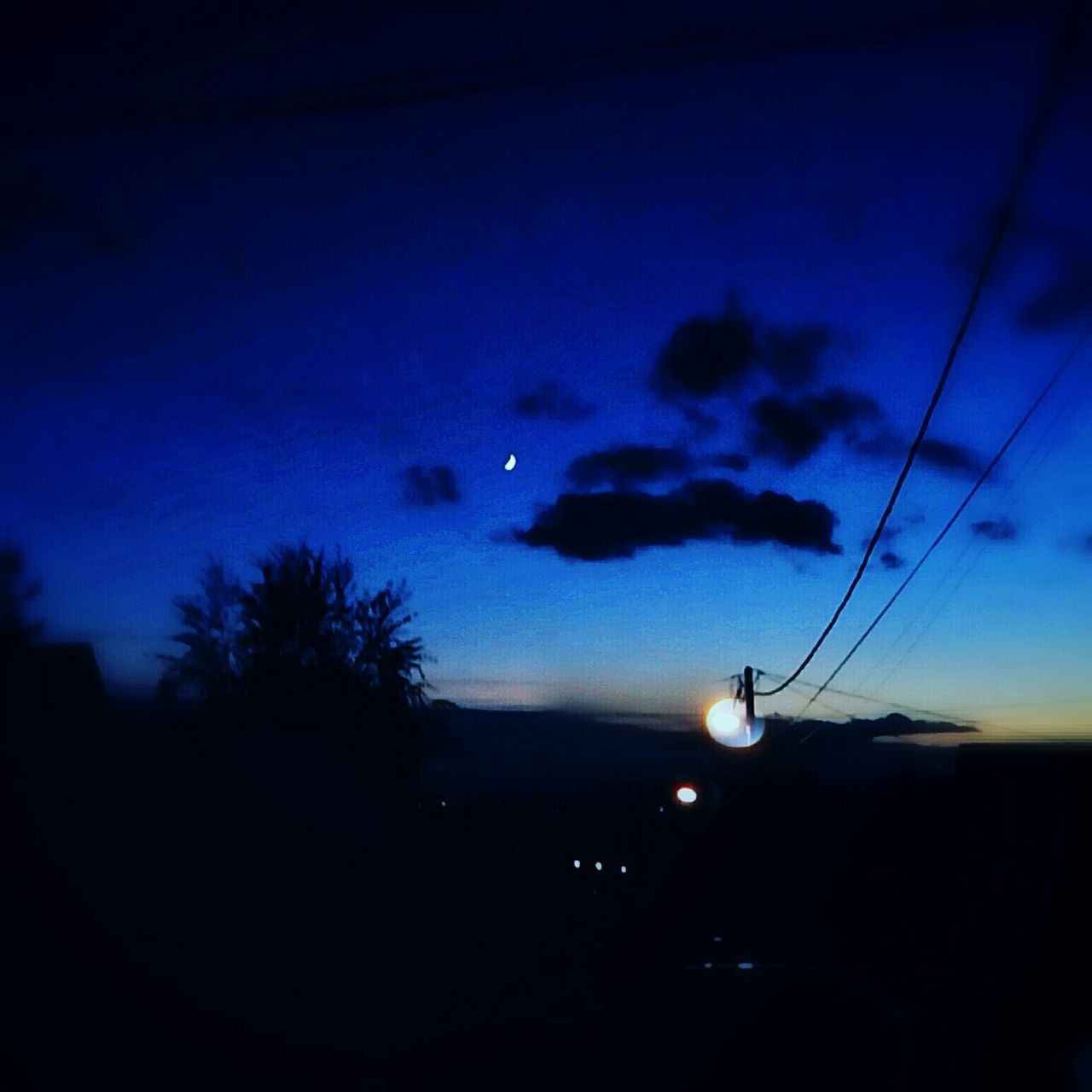 silhouette, sky, cable, nature, flying, no people, night, tree, outdoors, beauty in nature, sunset, scenics, blue, moon, water