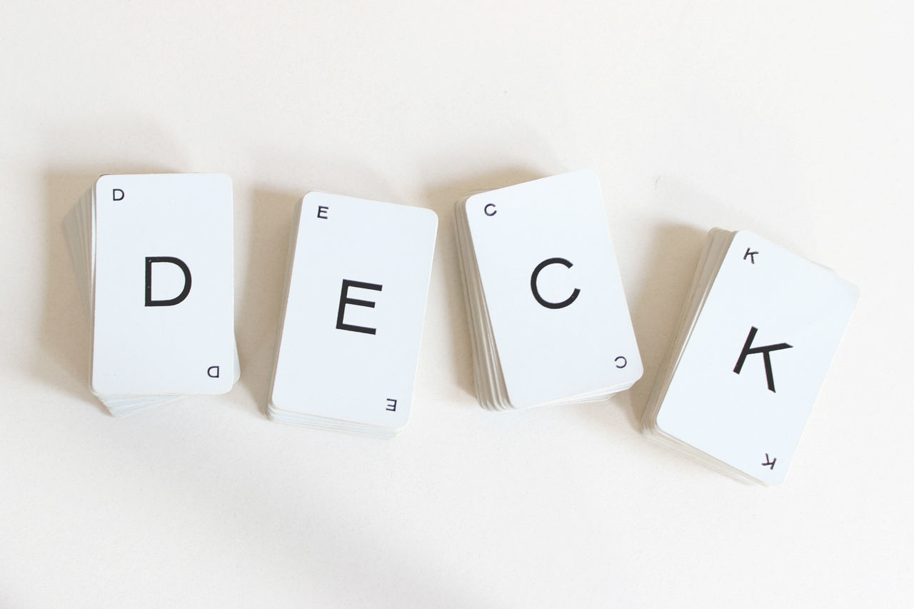 Stacked deck Cards Conceptual Decoration Ideas Idiom Stacked Still Life Studio Shot Unfair White White Background