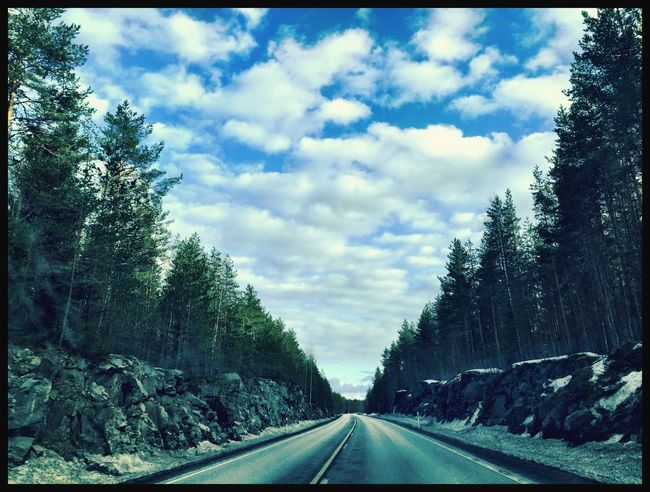 On the road again... Finland Driving Business Trip Skyporn Sky And Clouds Finnish Forest Blue Sky White Clouds Enjoying The View IPhoneography Taking Photos On The Road Again Heading South Deserted Road Endless Roads  Showcase April