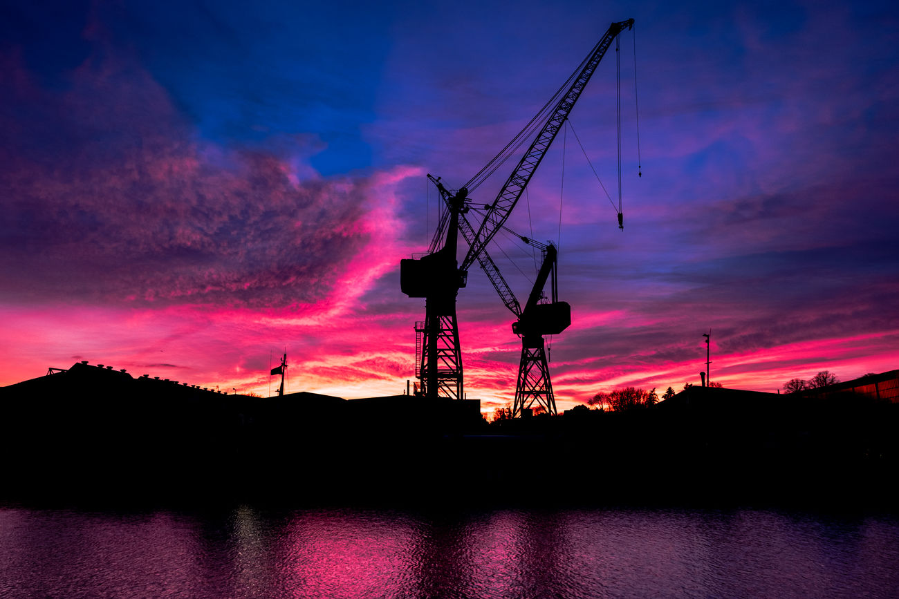 Good night everybody and dreams of springtime.... Beauty In Nature Colorful Cranes Evening Sky Fresh On Eyeem  Fujifilm XT-2 Golden Hour Industry Lübeck Millennial Pink Night No People Outdoors Riverside Romantic Sky Silhouette Silouette & Sky Sky Sunset Urban Water