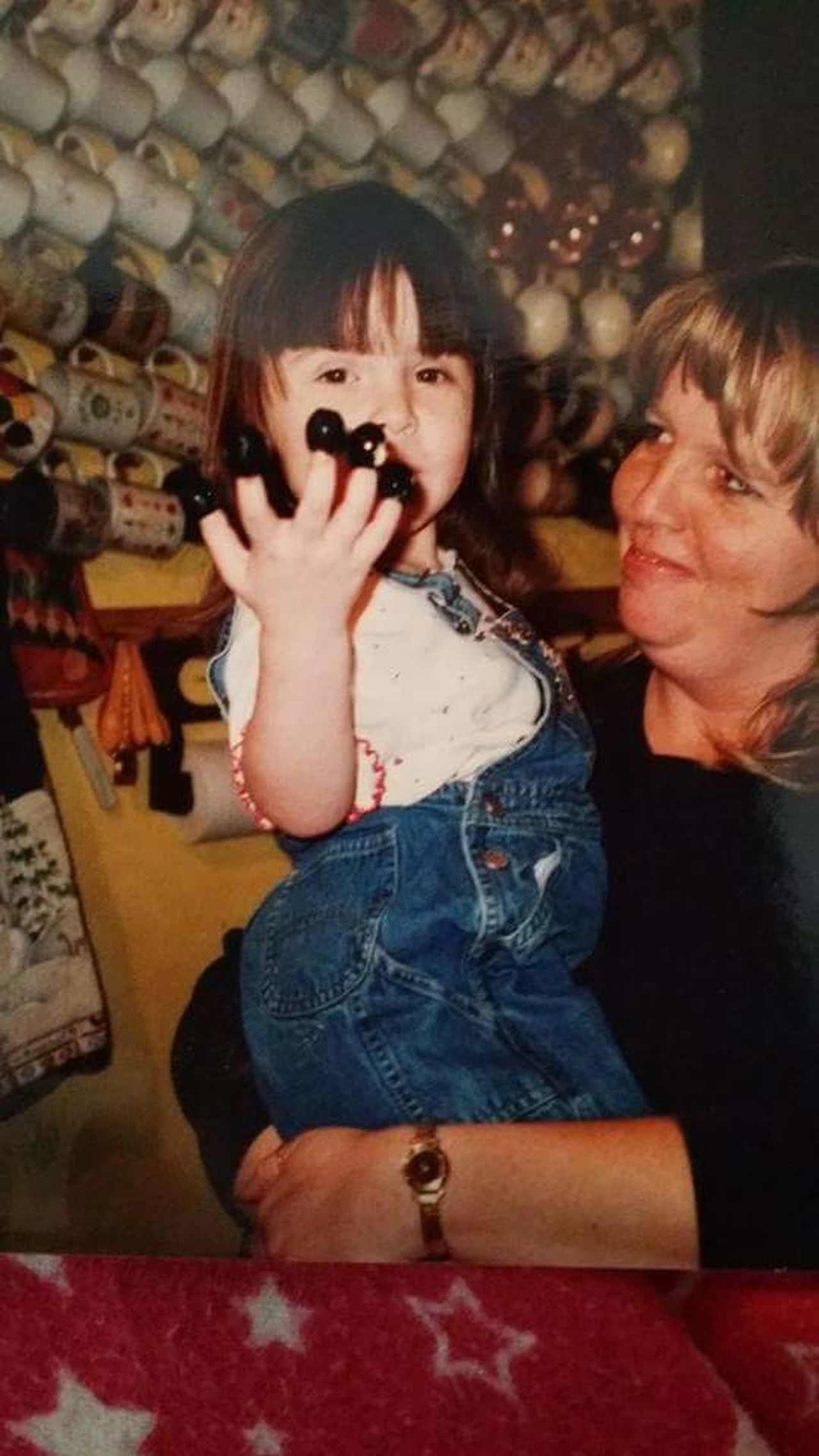 "I miss her so bad..... My Daughter she was about 3 and a half in this Picture this was at Thanksgiving .I Remember a couple days after she Died my Aunt  was trying to make me Smile and she did this, and came in the bathroom while I was taking a bath and said ""Michellie Mae!"". I said, I have a picture of Alycia with Olives on her fingers just like that, and I just started Crying again. It wasn't my aunts fault, she didn't know. But it just triggered that memory."