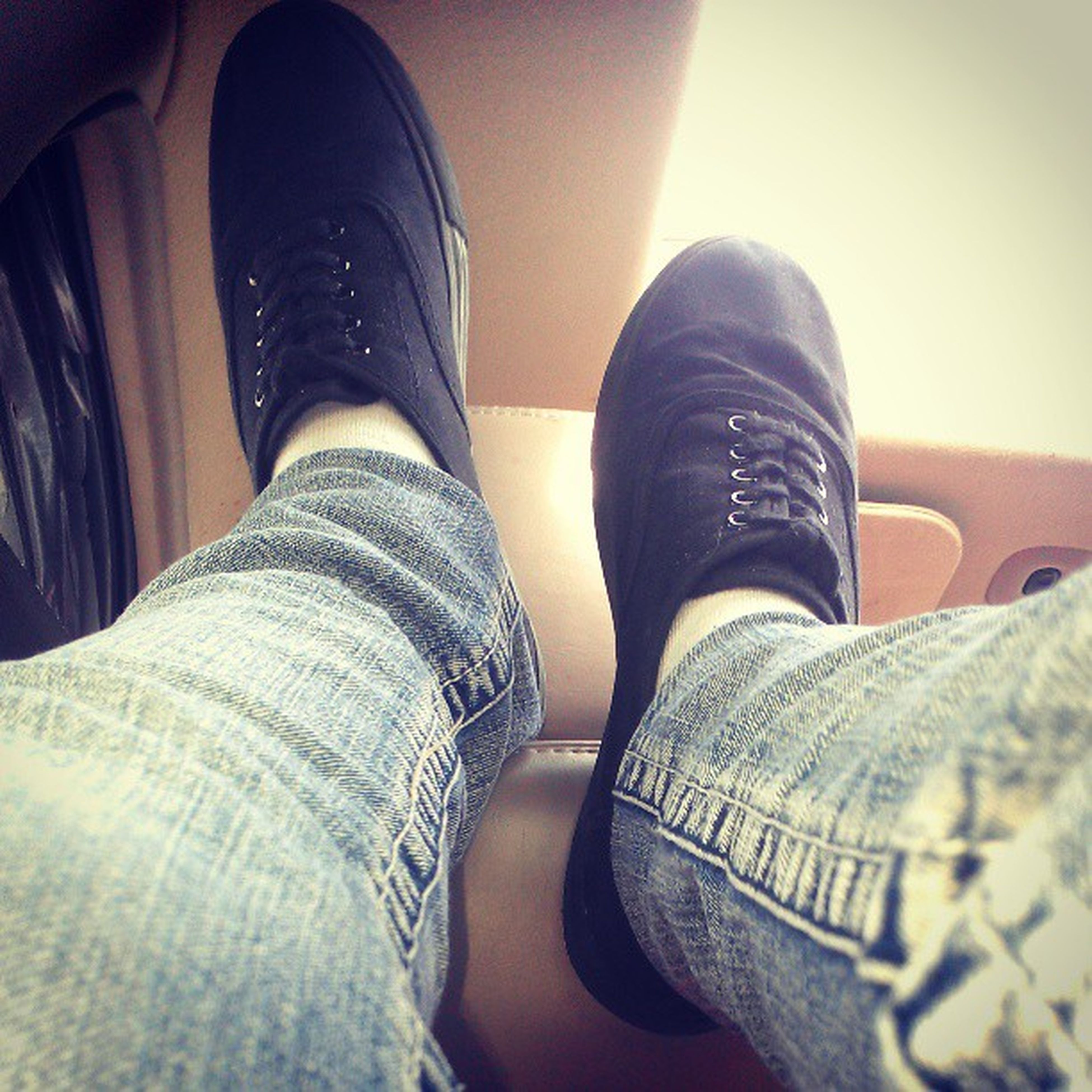 low section, person, shoe, jeans, personal perspective, indoors, lifestyles, human foot, footwear, standing, casual clothing, men, denim, leisure activity, sitting, fashion, close-up