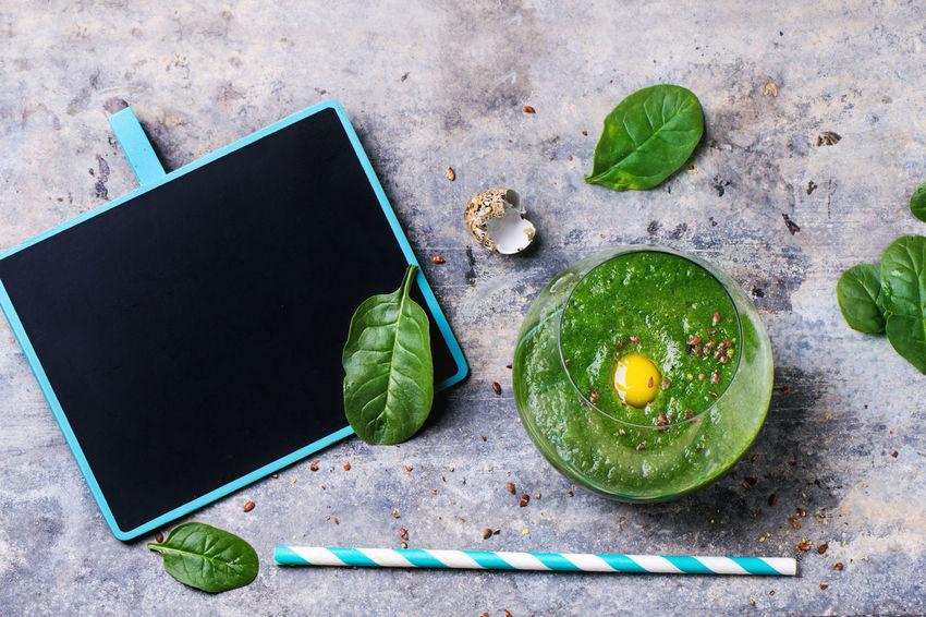 Glass of green smoothie with quail egg's yolk, served with cocktail tube, green apple and baby spinach leaves over tin surface. Top view. Apple Beverage Blank Breakfast Chalk Board Drink Food And Drink Food Photography Fresh Gray Green Green Smoothies Healthy Eating Healthy Food Healthy Lifestyle Overhead View Quail Egg Smoothie Spinach Top View Top View Of Food Yolk