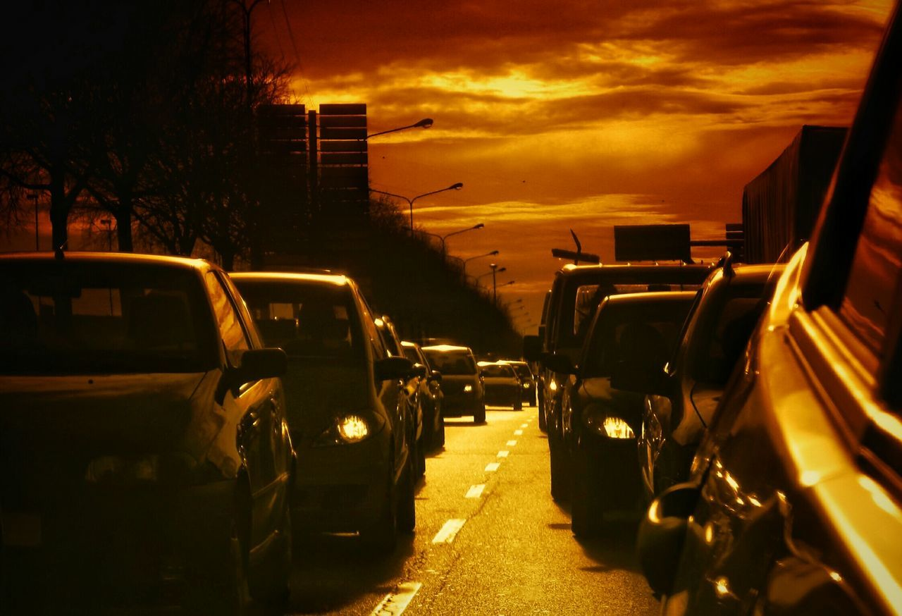 Cars On Road At Sunset