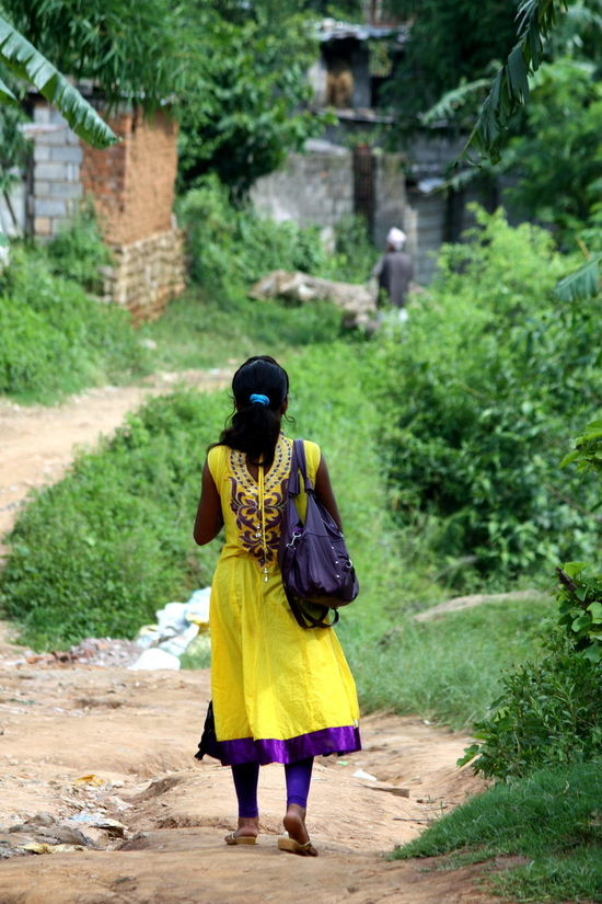 On her way ASIA Black Hair Focus On Foreground From Behind Full Length Kurta Nepal Person Walking Walking Alone... Walking Girl Yellow Color