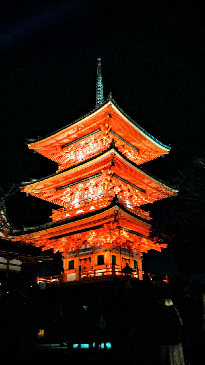 architecture, night, cultures, religion, place of worship, illuminated, built structure, building exterior, spirituality, low angle view, tradition, no people, shrine, travel destinations, outdoors, history, dragon, sky