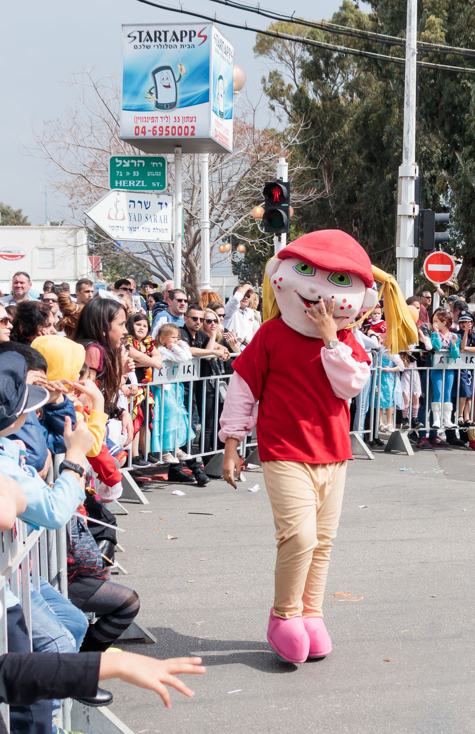 """Nahariyya, Israel, March 10, 2017 : Participant in the traditional annual carnival parade """"Adloyada"""" dressed in the suit of big rabbit goes near the viewers in Nahariyya, Israel Adloyada Adult Beauty Carnival Celebration Colorful Costume Culture Day Decoration Dressed Entertainment Festival Fun Happy Israel Masquerade Nahariyya Outdoors Parade Party People Style Traditional Travel"""