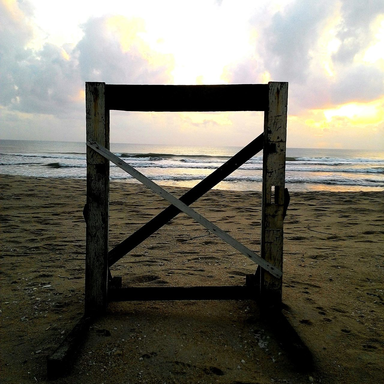 sea, water, beach, horizon over water, sky, tranquility, sand, nature, tranquil scene, cloud - sky, scenics, wood - material, beauty in nature, outdoors, no people, day, sunset, close-up