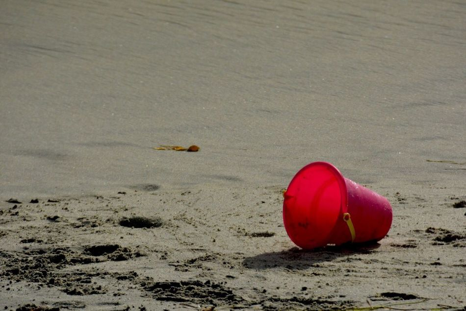 Left behind. Lonely Pink Childs Toy Lost And Found Bucket Beach Beach Toy