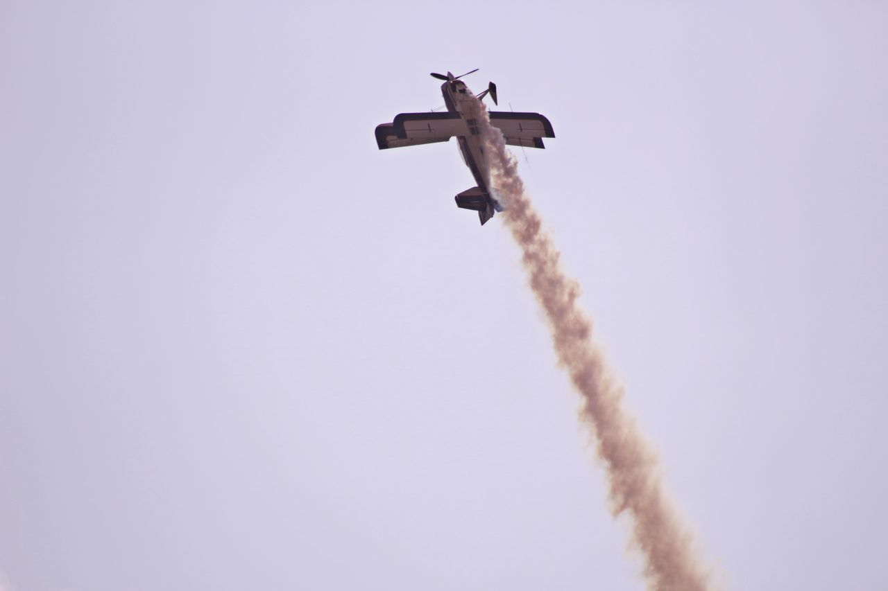 airplane ascending vertically Aerobatics Aerospace Industry Air Vehicle Airplane Airshow Clear Sky Day Flying Low Angle View Manouver Mid-air No People Outdoors Sky Smoke - Physical Structure Transportation Vapor Trail Vertical