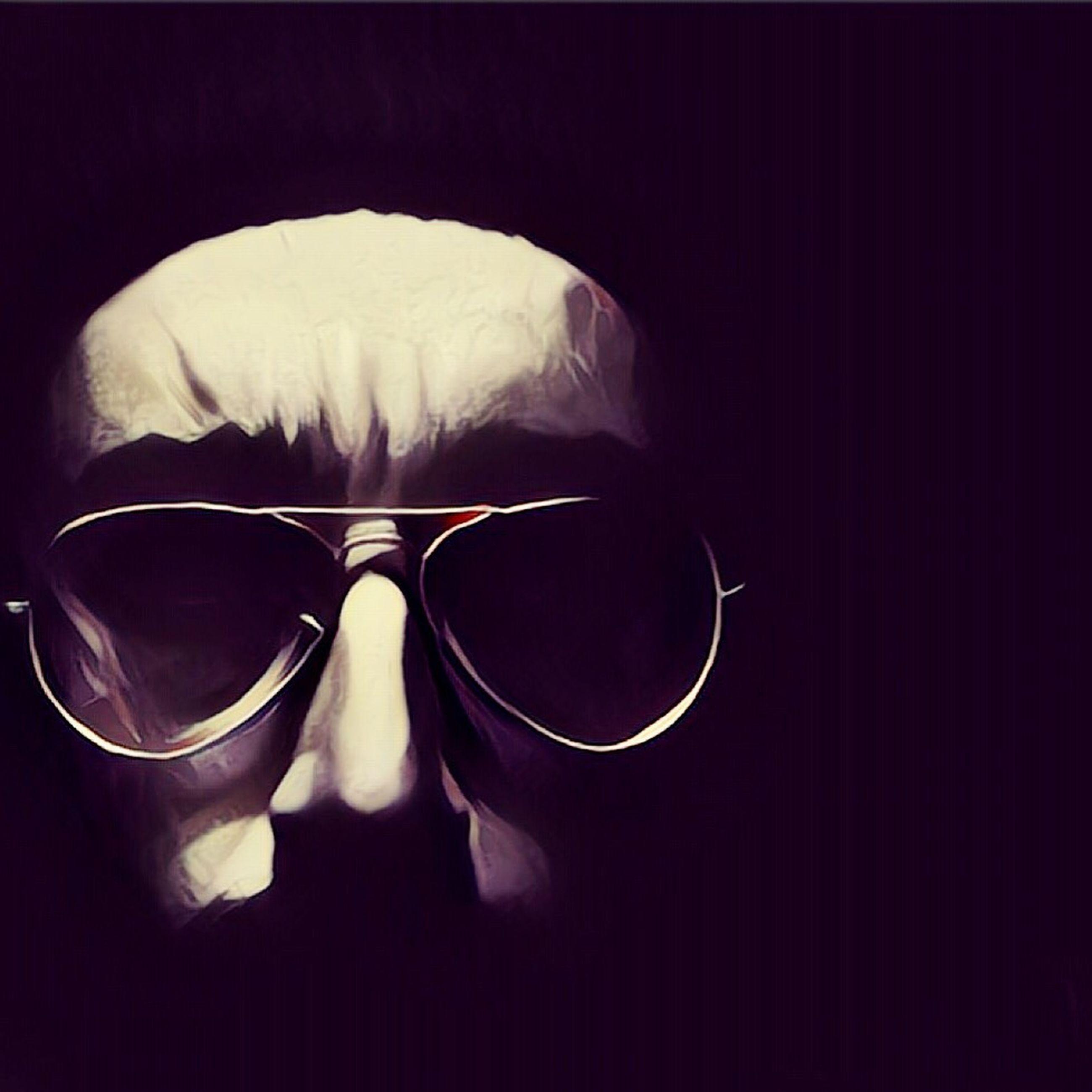 sunglasses, dark, studio shot, black background, full frame, fragility