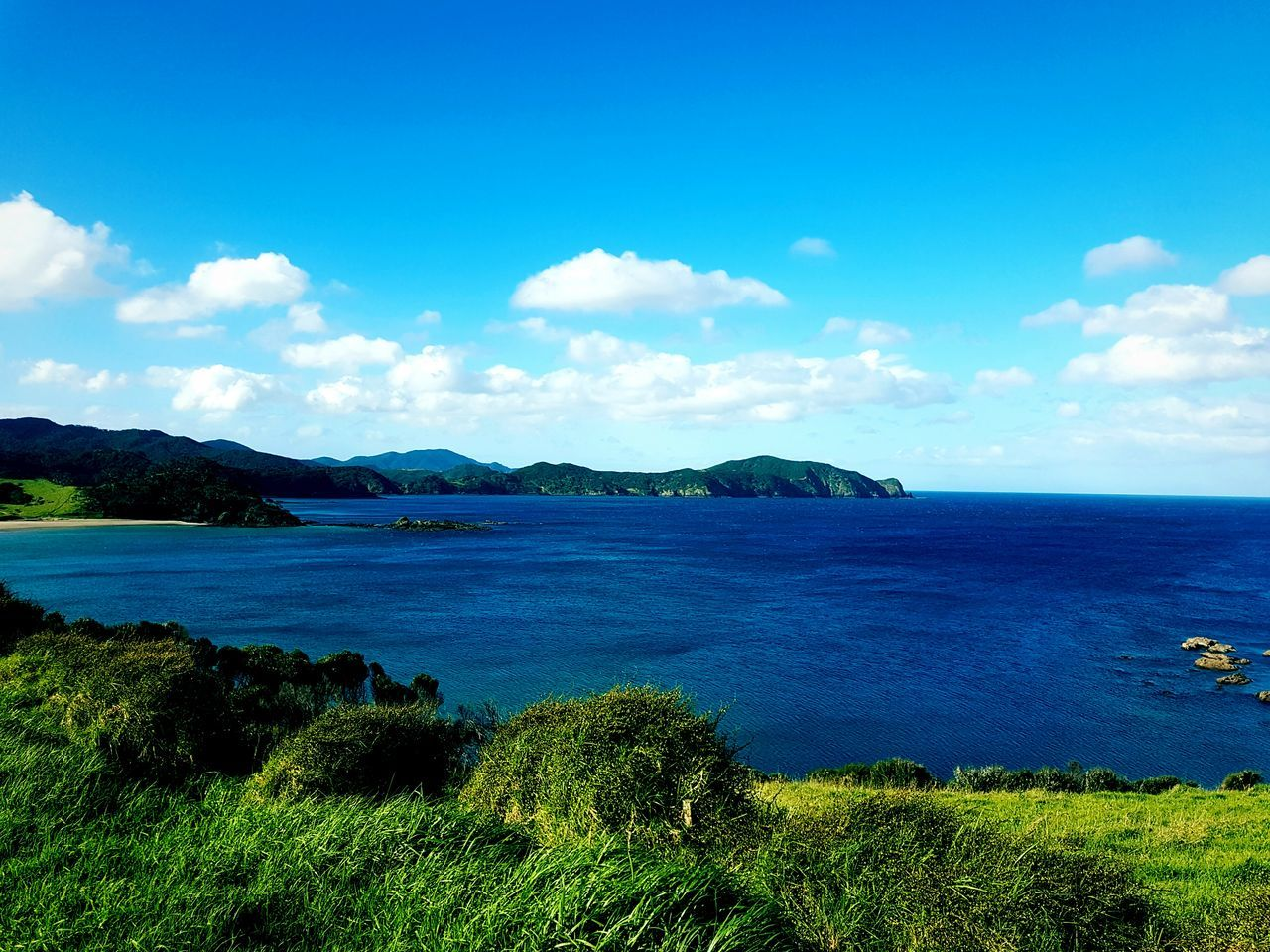 Looking over Rawhiri Beautiful Nature Blue Water Scenics Tranquility Sky Mountain Sea Nature Calm Day Mountain Range Outdoors Seascape Cloud - Sky Beauty In Nature Beachphotography Grass Clear Sky Horizon Over Water Tranquil Scene Nature Coastline Calm Vacations