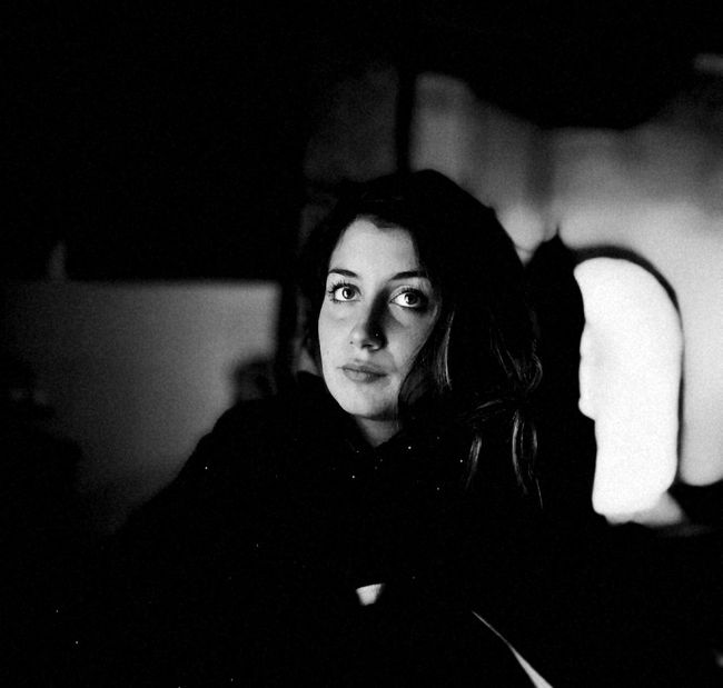 ·Thinking Loud· MyGIRL Indoors  Monochrome Photography Young Adult Lifestyles Leisure Activity Front View Dark Long Hair Casual Clothing Looking At Camera Contemplation Darkroom