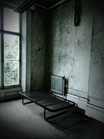 Eerie Building Interior Building Urban Decay Dilapidated Urban Decay Interior Indoor Urbanphotography Abandoned Decaying Derelict Aftermath Baron  Cell Prison Digs Student Bed Frame Eyeemphoto Urbex Urbexexplorer Minimalist Architecture The Secret Spaces