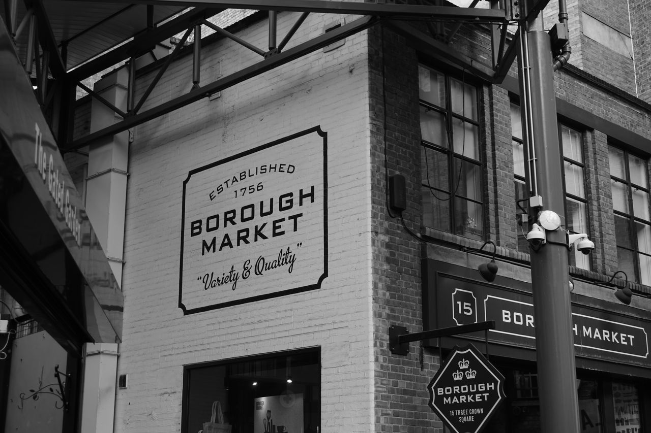Market // Sony a6000 // Advertising Architecture Blackandwhite Borough Market Building Exterior Built Structure Day EyeEmNewHere London Low Angle View Market Outdoors Sign Sony A6000 Text This Week On Eyeem United Kingdom Welcome The City Light