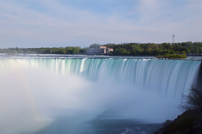 Water Motion Long Exposure Waterfall Beauty In Nature Nature Dam Outdoors Power In Nature Scenics Sky Blue Day No People Hydroelectric Power Built Structure Tree Clear Sky Architecture