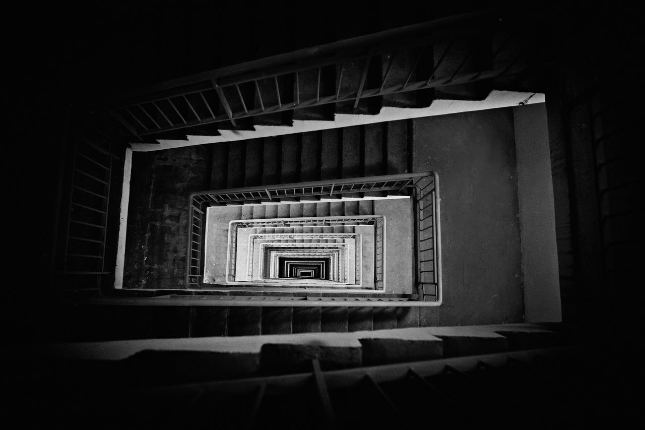 stairway down top view. Black and white photography. Abstract stairs. Abstract Architecture Best  Black And White Built Structure Day EyeEm Best Edits Eyeem Best Shot EyeEm Best Shots - Black + White High Angle View Monochrome No People Railing Spiral Spiral Stairs Staircase Stairs Stairway Stairways Steps Steps And Staircases Streetphoto_bw