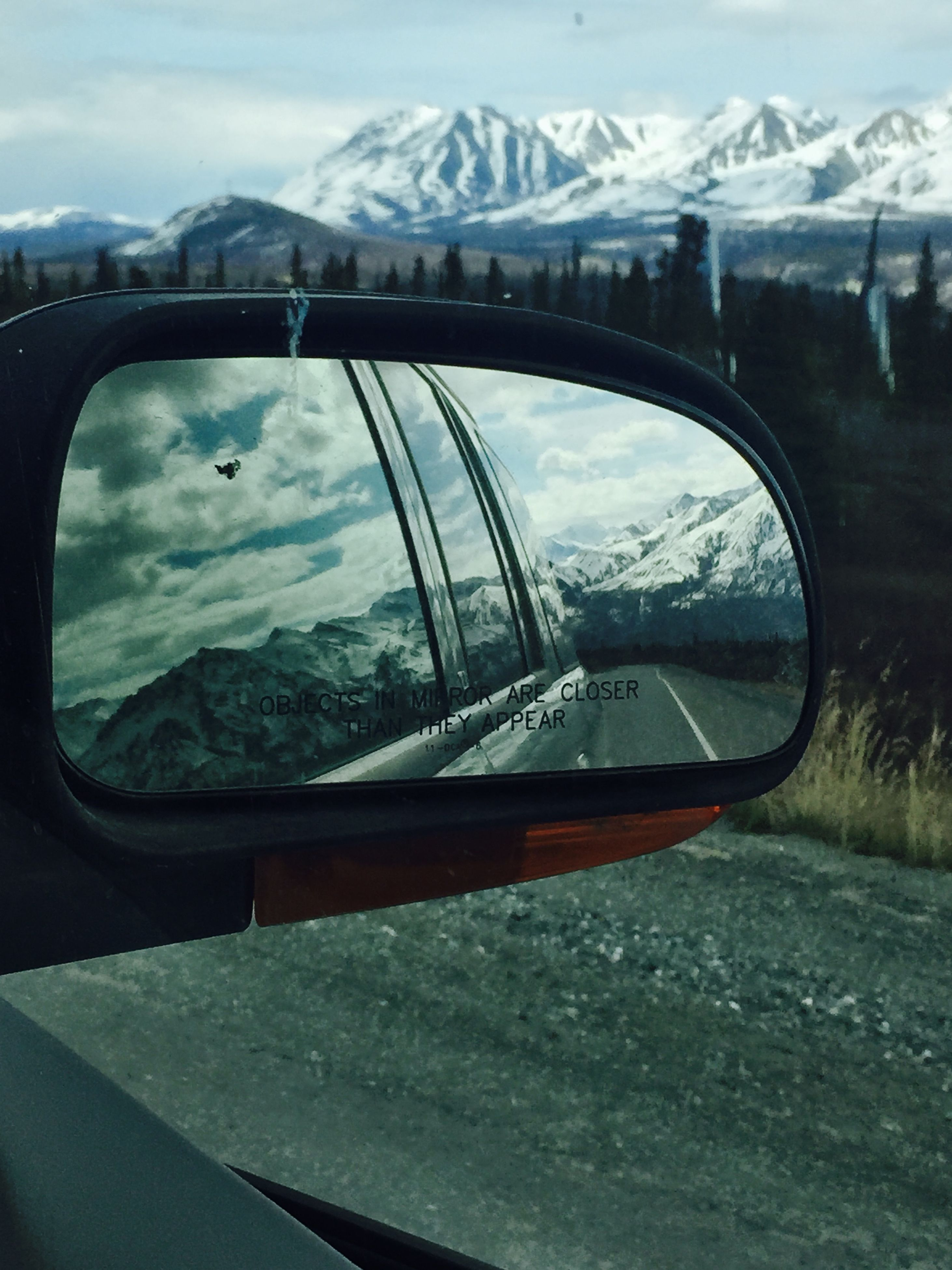 transportation, mode of transport, mountain, sky, snow, land vehicle, car, winter, cold temperature, season, reflection, road, cloud - sky, mountain range, weather, side-view mirror, landscape, travel, nature, part of