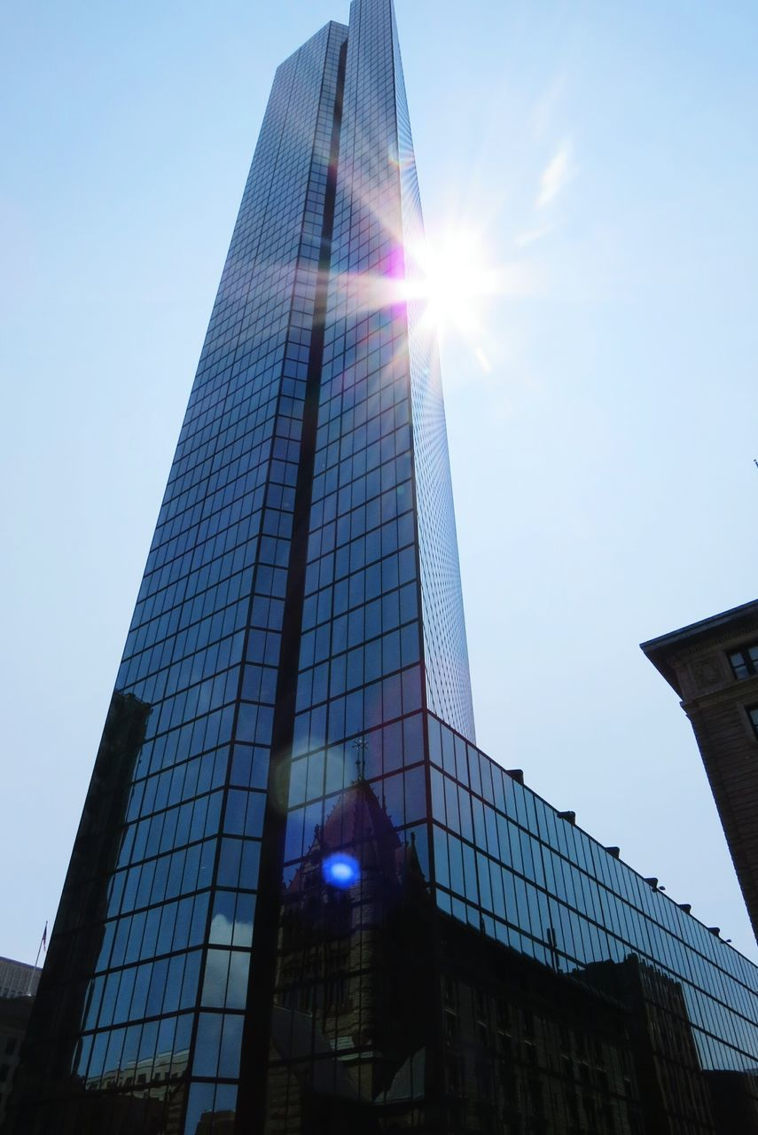 lens flare, sun, sunbeam, sunlight, low angle view, architecture, built structure, building exterior, sky, modern, no people, outdoors, day, city