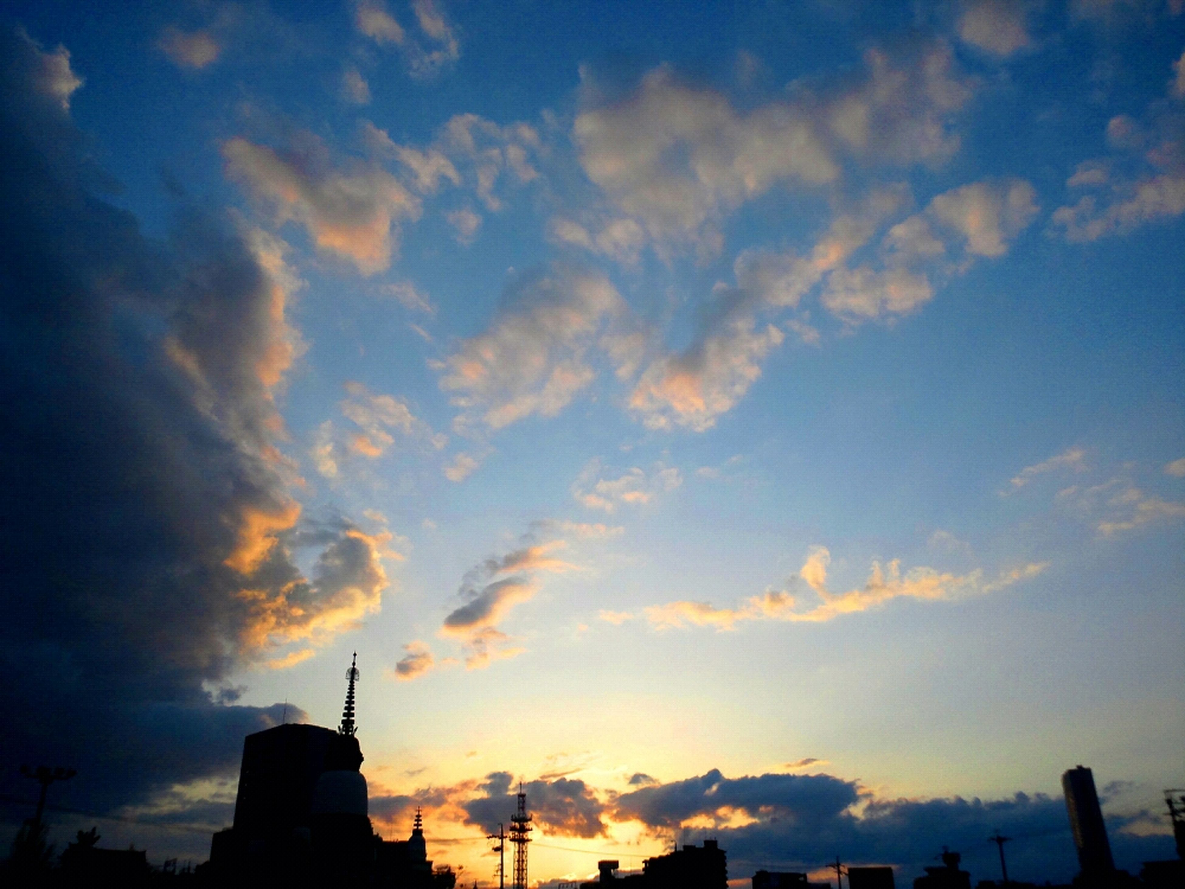building exterior, architecture, built structure, sunset, sky, silhouette, low angle view, cloud - sky, city, orange color, cloud, building, outdoors, cloudy, no people, dusk, tower, tall - high, nature, dramatic sky
