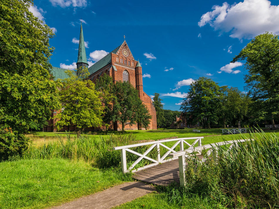 Cathedral in Bad Doberan, Germany. Architecture Bad Doberan Building Exterior Cathedral Clear Sky Day Grass History Landmark Minster No People Outdoors Place Of Worship Religion Sky Tower Travel Destinations Tree