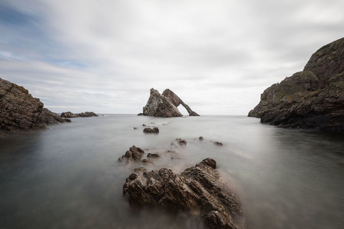 Bow Fiddle Rock, Portknockie Bow Fiddle Rock, Beauty In Nature Cloud - Sky Day Long Exposure Nature No People Outdoors Rock - Object Scenics Sea Sky Tranquil Scene Tranquility Water