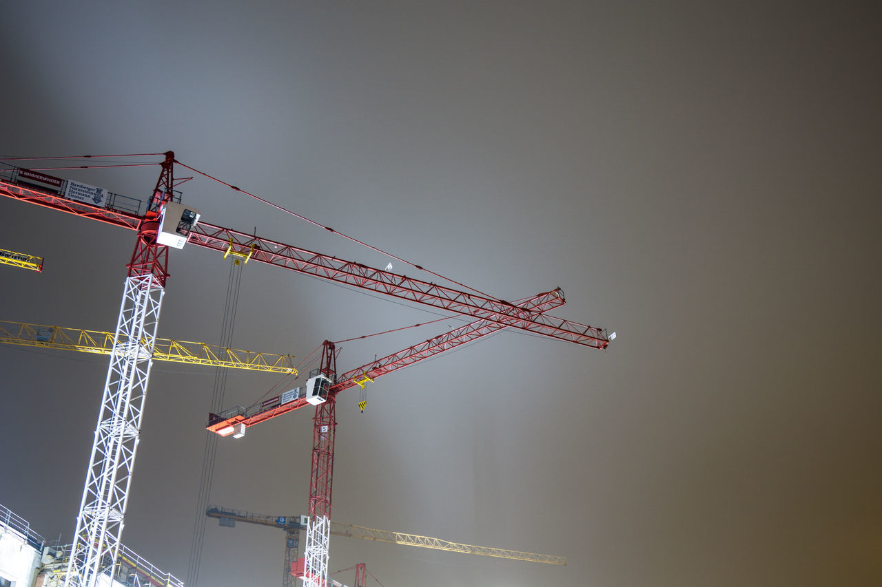 Construction cranes in the fog Berlin Cloud - Sky Construction Construction Crane Construction Site Construction Site Day Fog Horizontal Low Angle View Nature Night Photography No People Outdoors Sky Water