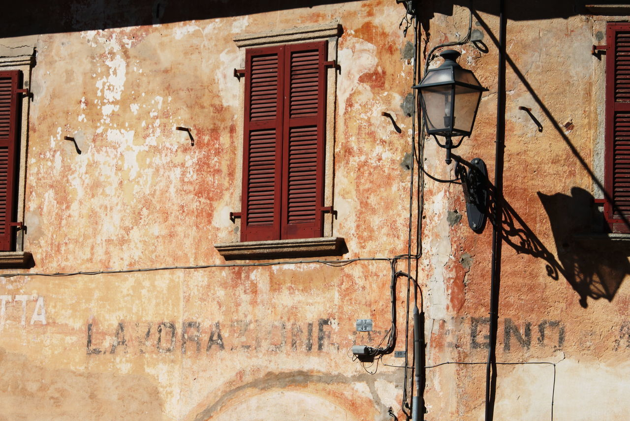 Ameno Town Architecture Building Exterior Close-up Day Deterioration Italy Lamp March 2017 No People Outdoors Piemonte Sunlight And Shadow Window