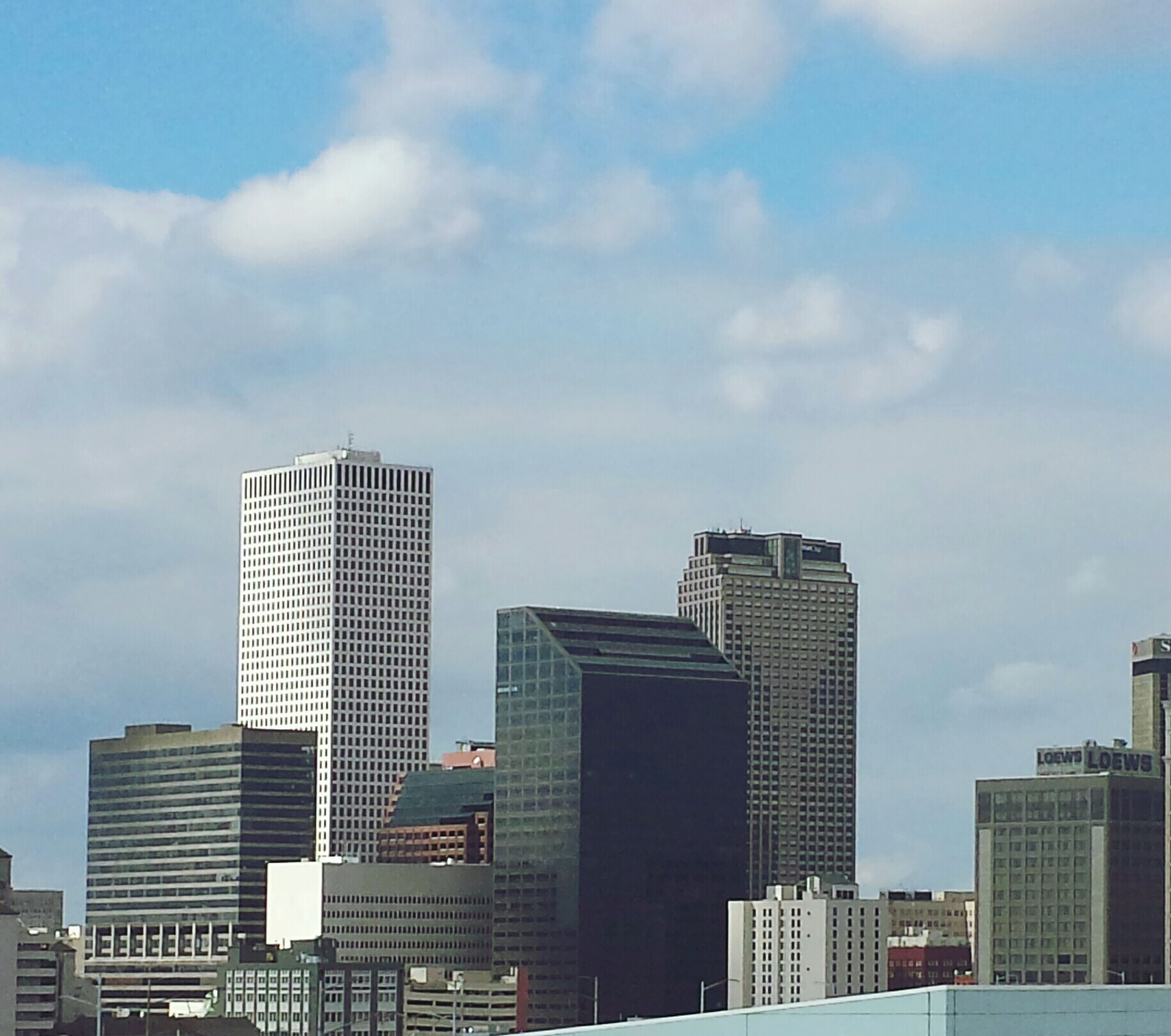 building exterior, architecture, city, built structure, skyscraper, modern, office building, sky, tall - high, tower, cityscape, urban skyline, low angle view, cloud - sky, financial district, building, cloud, city life, skyline, tall