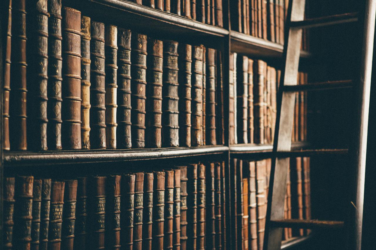 Old books on Trinity college library Archives Book Bookshelf Dublin Ireland Library Shelf Trinity College