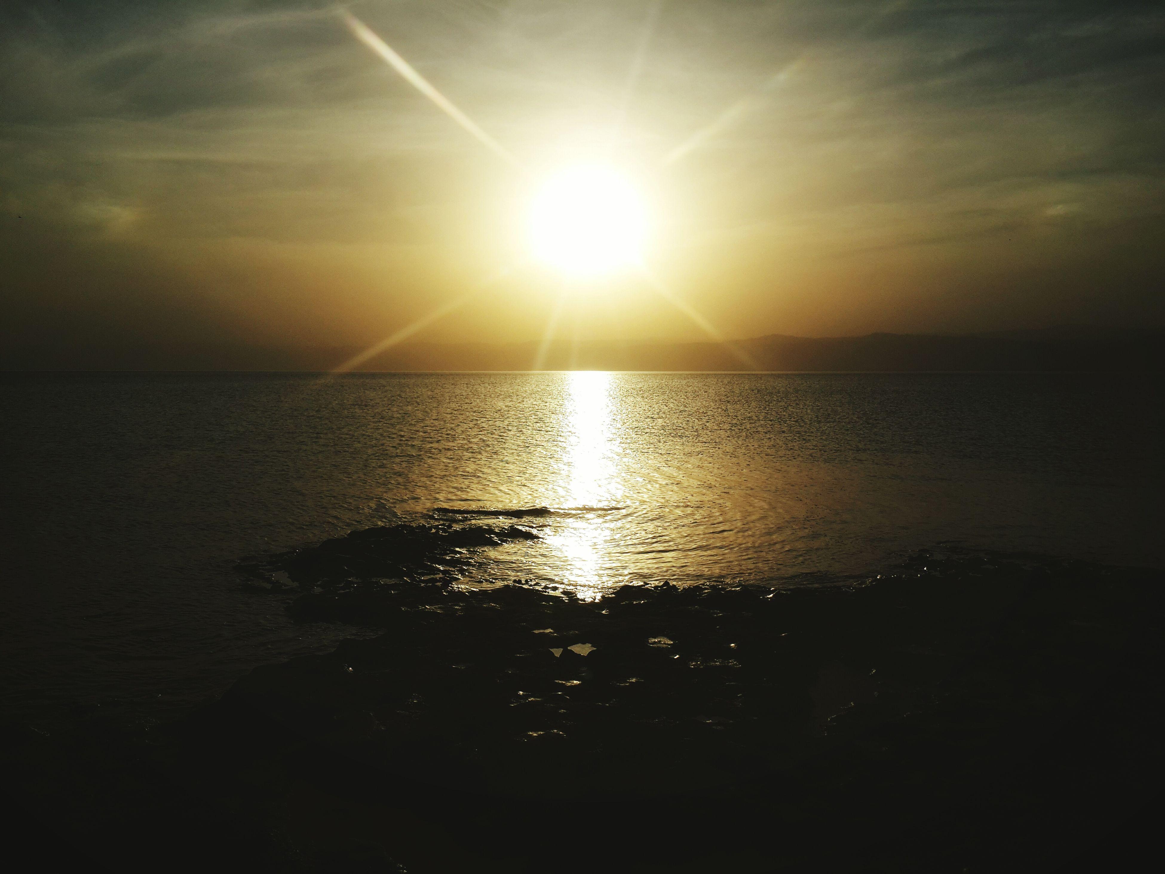 water, sun, sea, horizon over water, reflection, tranquil scene, sunset, scenics, tranquility, beauty in nature, sky, nature, sunlight, idyllic, silhouette, waterfront, rippled, sunbeam, beach, outdoors